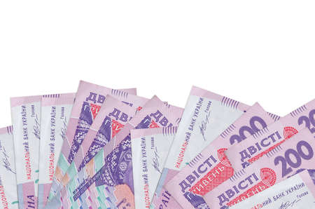 200 Ukrainian hryvnias bills lies on bottom side of screen isolated on white background with copy space. Background banner template for business concepts with money Фото со стока