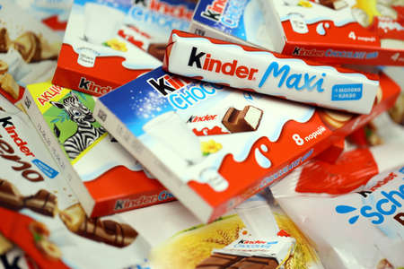 KHARKOV, UKRAINE - DECEMBER 8, 2020: Many different products by Kinder brand made by Ferrero SpA. Kinder is a confectionery product brand line of Italian multinational manufacturer Ferrero