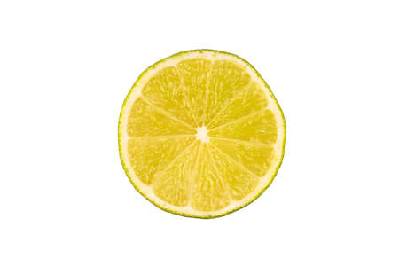 Slice of green lime on light white background. Fresh fruit with copy space for text Banco de Imagens