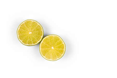 Halves or slices of green lime on light white background. Fresh fruits with copy space for text