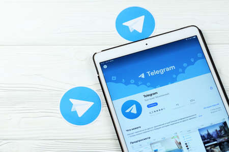 KHARKOV, UKRAINE - FEBRUARY 14, 2021: Telegram app in app store market on ipad display screen. Telegram is a freeware cross platform cloud based instant messaging IM software and application service