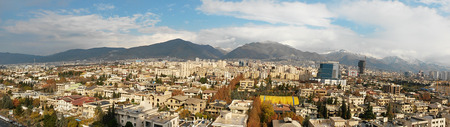 aerial panorama view of tehran metropolitan city with a beautiful rainbow background
