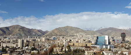 uptown: a beautiful bird eye view of tehran metropolitan city with a beautiful rainbow background