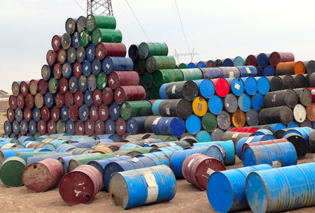 Huddle of colourful oil barrels caused to environment pollution