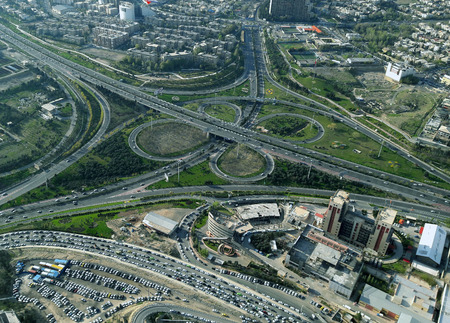 high rise buildings: modern view of tehran showing complex highwayes