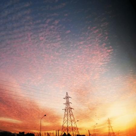 Electricity pylons in a sunrise background Lizenzfreie Bilder