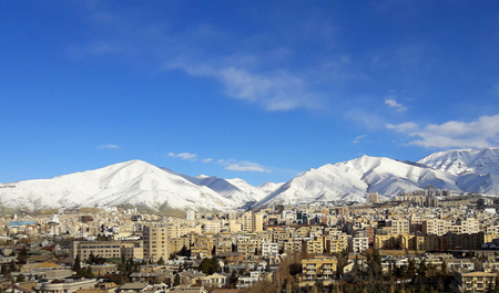 uptown: Tehran landscape view with a blue sky and snowy mountain in background