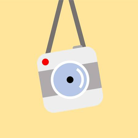 Digital camera hanging on the wall in simple vector image