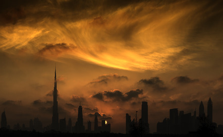 united: A sunset view of Dubai downtown in a magnificent cloudy evening. Stock Photo