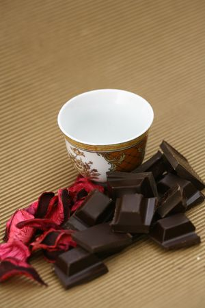 cup, rose petals and chocolate arbitrary image photo
