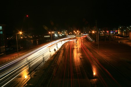 Blurred Motion of Car Lights on Highway at Night photo