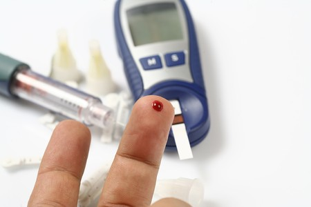 prick: Diabetic is doing a glucose level finger blood test