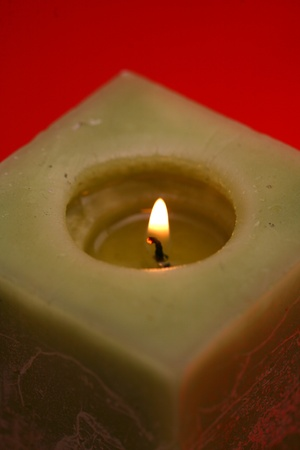 Close-up candle illuminates the darkness of the night environment photo