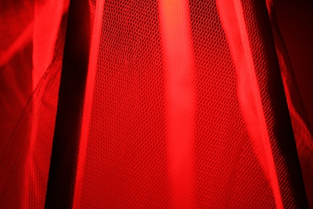 Red light is reflected through the gauze curtain photo