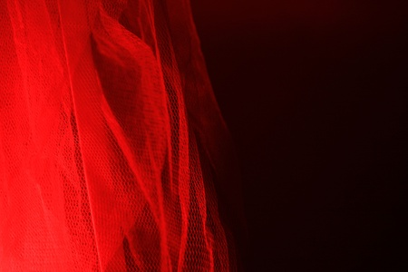 red centre: Red light is reflected through the gauze curtain Stock Photo