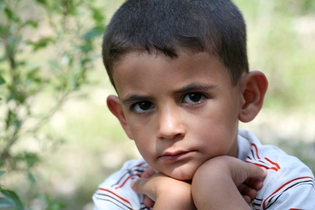 Little boy looking at camera. Stock Photo