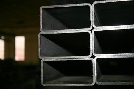 tubing: metal pipes on black background Stock Photo