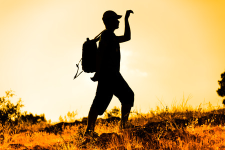 real leader: that climbers trekking at sunset Stock Photo