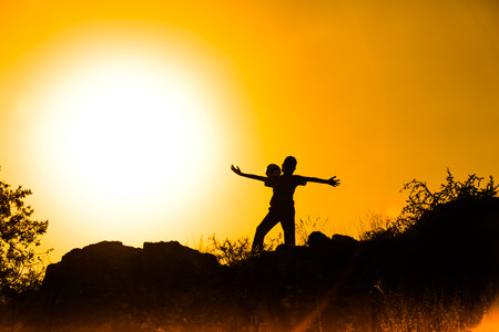boys play at sunset