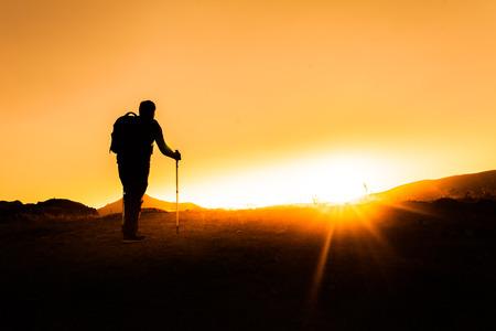 sunset trekking shooting silhoutte Stock Photo