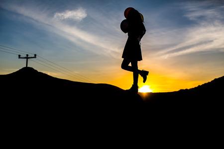 suntanned: A beautiful woman silhouette at sunset