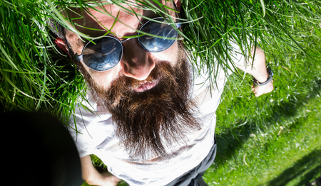 reverse: Man who looks upside down in the green of spring
