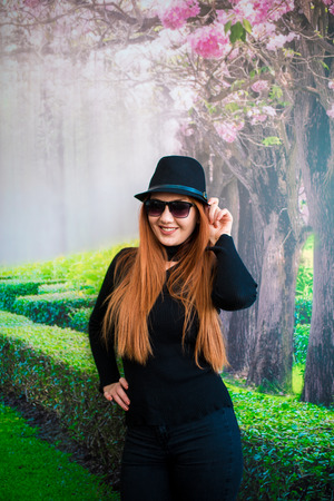 A beautiful blonde girl wearing sunglasses and a hat posing Stock Photo