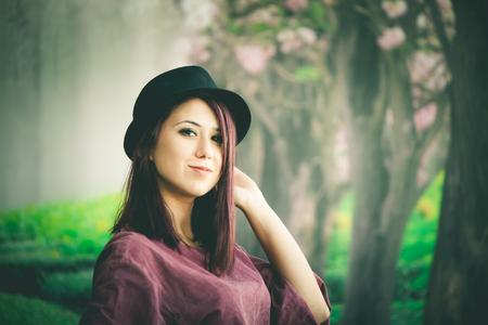 A beautiful girl wearing a hat posing