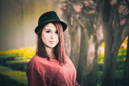A beautiful girl wearing a black hat posing Stock Photo