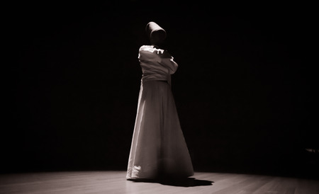 the image of a whirling Dervish in the darkness