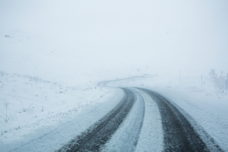 the man who is in the road that is snow