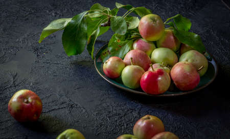 image of new crop apples on an old table