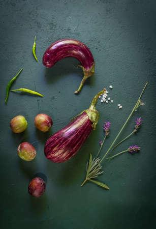 Preparation with vegetables on dark ground in the kitchen