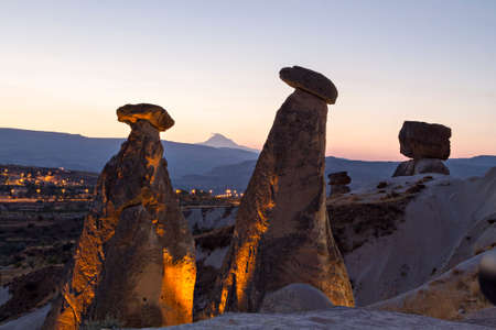 Fairy chimneys and the peak of Mount Erciyes, at the sunrise in Cappadocia, Turkey