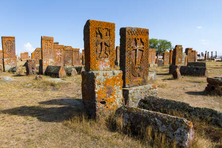 Historical tombs and head stones known as Khachkars or Armenian cross stones, in the ruins of the ancient cemetery of Noratus, in Armenia