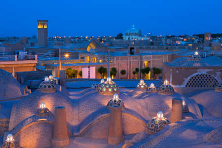 Domes of historical bath and view over the ancient city of Kashan at the twilight, Iran