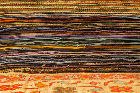 Stack of oriental carpets and rugs, Turkey