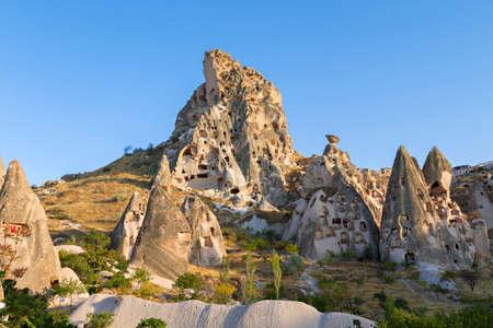 Rock formations and cave dwellings in the old town Uchisar, Cappadocia, Turkey
