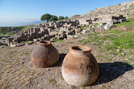 Ancient terra cotta jars in the ruins of the Roman city of Pergamum known also as Pergamon, Izmir, Turkey