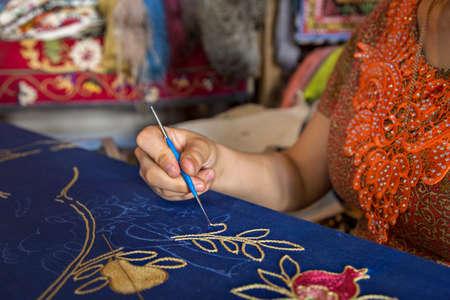 Uzbek woman making embroidery, in Bukhara, Uzbekistan