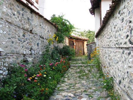 mn: Bulgaria,Zlatograd-old street with flowers Stock Photo