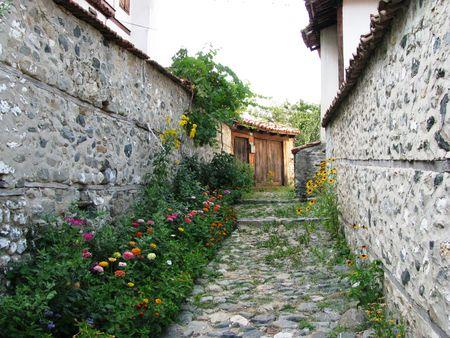 Bulgaria,Zlatograd-old street with flowers Stock Photo