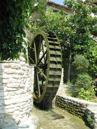 balchik: Wooden spinning wheel of an old mill in Balchik.