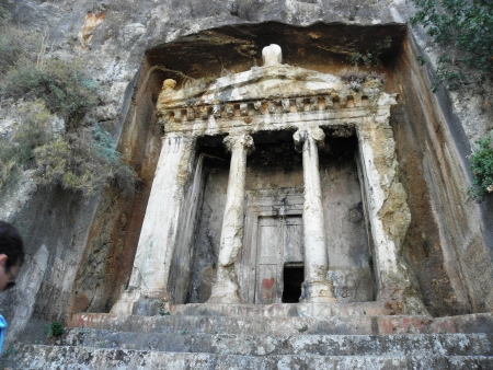 Rock tombs resembling the facade of the ancient temple of Telmessos now Fethiye on the Mediterranean  Stock Photo