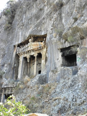 fethiye: Rock tombs resembling the facade of the ancient temple of Telmessos now Fethiye on the Mediterranean  Stock Photo