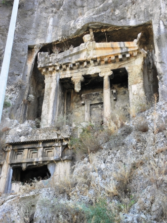 fasade: Rock tombs resembling the facade of the ancient temple of Telmessos now Fethiye on the Mediterranean  Stock Photo
