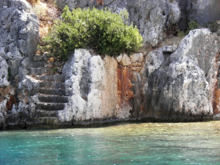 remained: Steep stone steps leading to the residential area remained under sea level due an earthquake in the Gulf of Kekova  Stock Photo