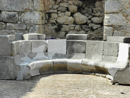 Stone benches in the Byzantine basilica from 3-4 century in ancient Caunos.