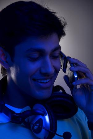 tasking: A man talking on his mobile phone
