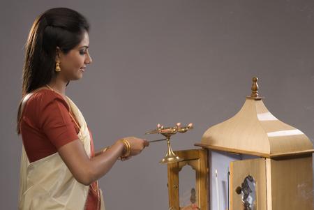 devotee: A woman praying
